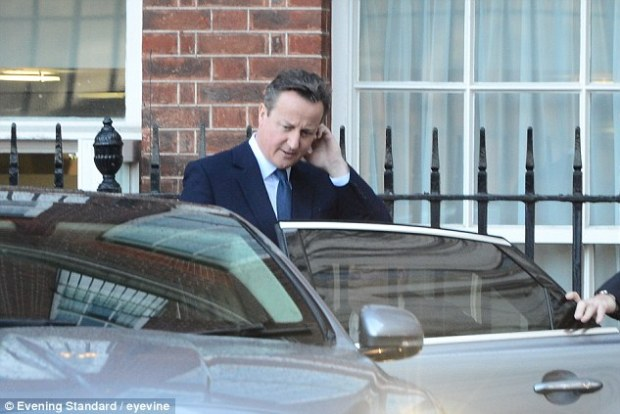 Mr Cameron, seen at the rear entrance to Downing Street today, has insisted there remains a lot of hard work to be done before the EU summit later this month where he hopes to conclude today's deal