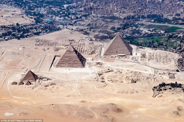 During a flight to Cairo in Egypt, Gottwald snapped away at a series of pyramids in a desert in Egypt