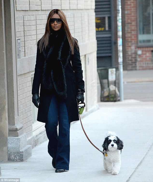 Brave: Model Iman Abdulmajid has been seen for the first time since her beloved husband David Bowie passed away from cancer - she walked her dog Max while in New York City on Tuesday