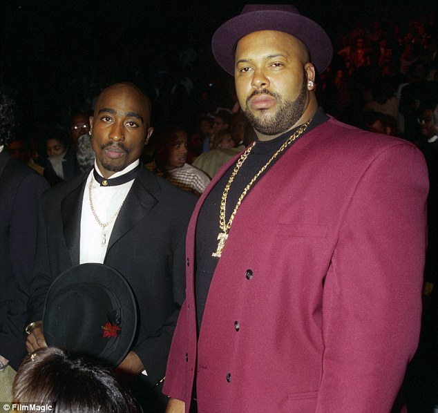 Kading says that in retaliation for Tupac's death, his manager Marion Hugh 'Suge' Knighthired rival Blood gang member Wardell 'Poochie' Fouse to kill Diddy's long-time friend Biggie Smalls for just $13,000. Above: Tupac and Suge are pictured together