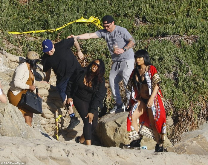 Packing up: The gang gathered their belongings together as they left the beach, with Blac covering up in a red kaftan