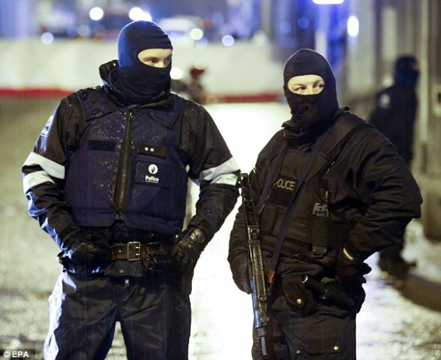 Belgian police have seized a video which reportedly shows an unconscious girl being gang-raped by a group of Iraqi migrants (file picture of unrelated police operation in Belgium)