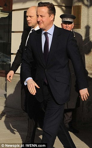 David Cameron, pictured in Warsaw today, claimed his 'emergency brake' would have a 'substantial' impact on reducing EU migration to the UK but figures released by HMRC cast doubt on his claims