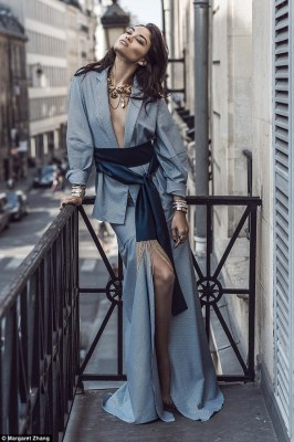 The camera loves her! Shanina Shaik, 24. has been featured in a new fashion editorial photographed by Margaret Zhang of Shine By Three, in which she can be seen going braless as she strikes a variety of fierce poses