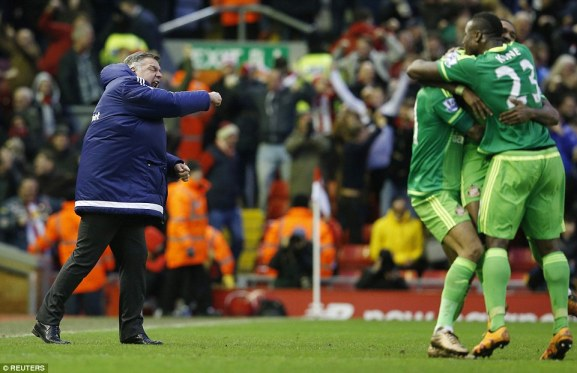 Sunderland manager Sam Allardyce (left) celebrates as his side battled back to earn a crucial point against Liverpool