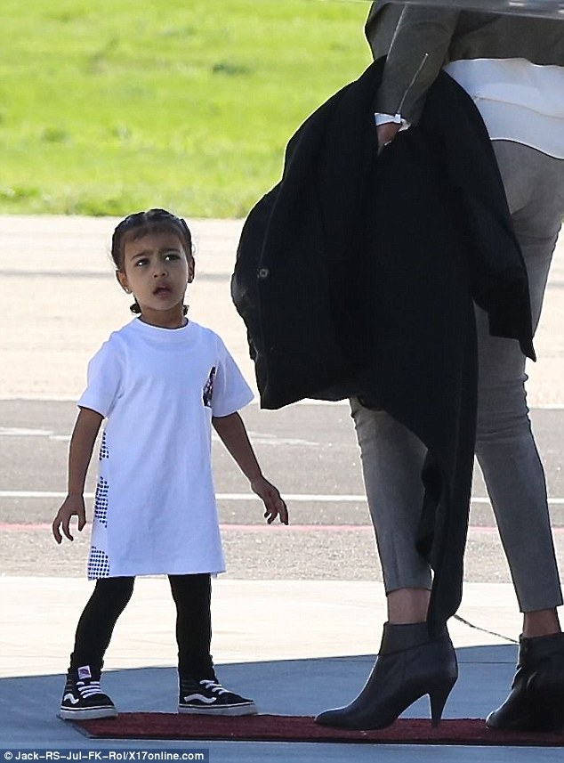 Bonding: North and Caitlyn waited on the red carpet before boarding the private jet