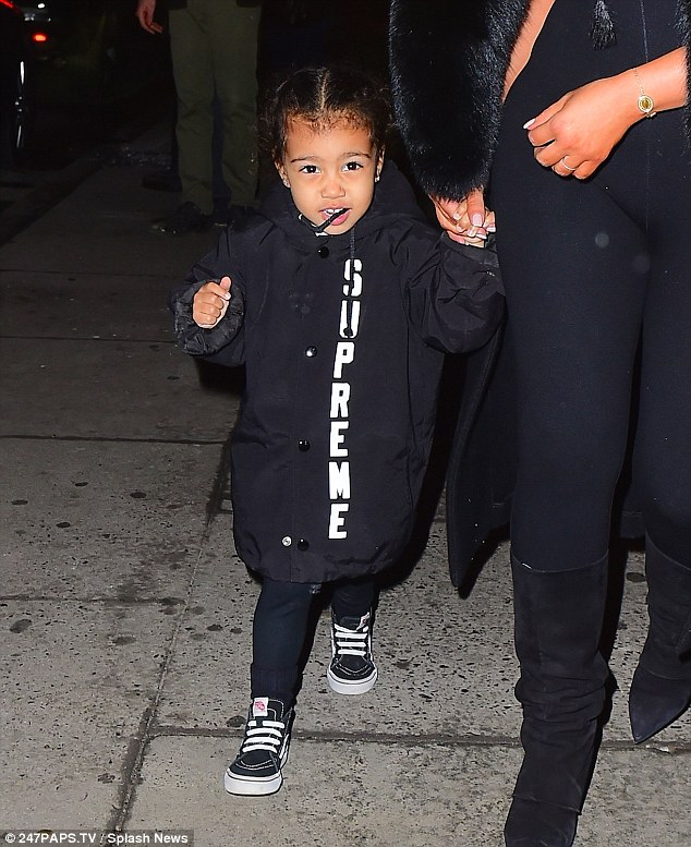 Big fan: When the listening party was over, the three-year-old was more awake and walked put holding her mom's hand