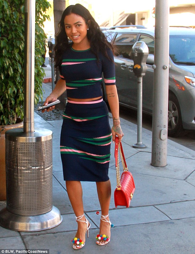 Simple design: The colourful dress featured a combination of pink and green stripes