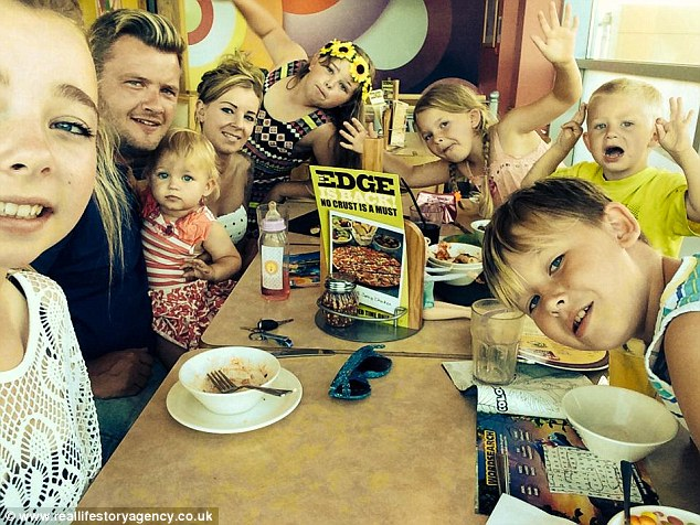 Donna and husband Patrick with their children -Angel, two, Vinne, five, Jessica, eight, Cameron, 10, Danielle, 12 and Mya, 14
