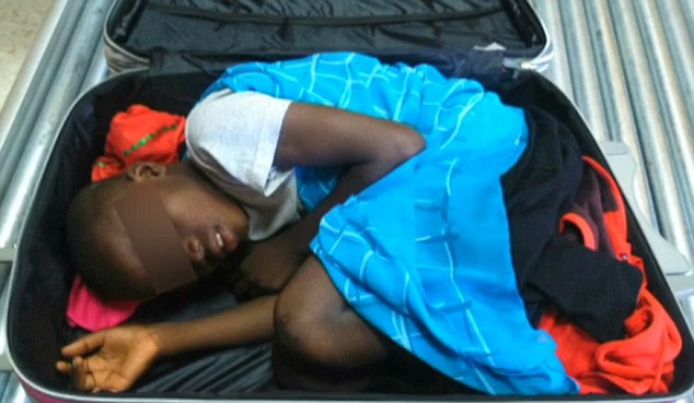 This boy from Africa tried to enter the enclave of Melilla curled up inside a travel suitcase