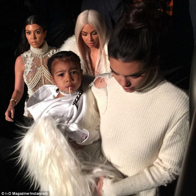 What a carry on: Kim decided to let Kendall carry North so she could have the limelight to herself