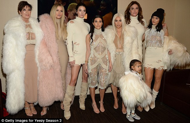 One for the photo album: The whole Klan decided to pose backstage sans Kanye
