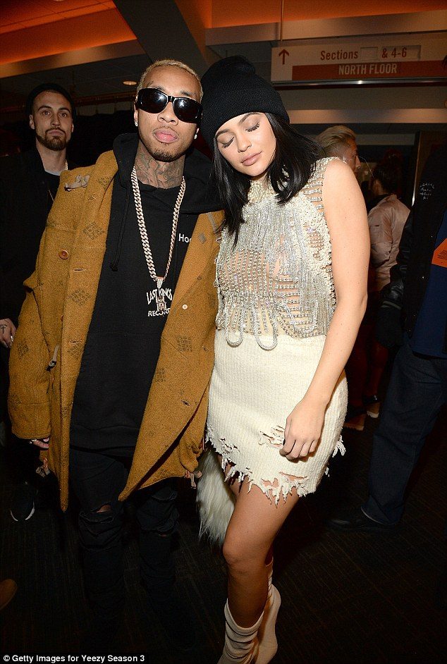 Her main man: Kylie Jenner snuggled up to Tyga at the Yeezy Season 3 show in New York on Thursday