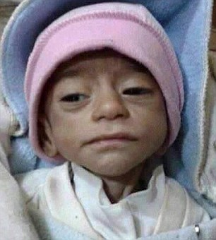 Starving: Baby Akab is pictured just days before he starved to death, lovingly swaddled by his mother. At just three months old, he was one of thousands of hungry children bearing the brunt of an ISIS siege in Syria