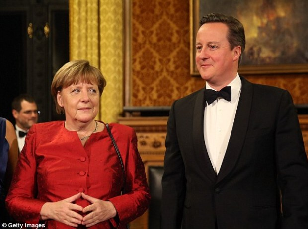 British Prime Minister David Cameron (R) and German Chancellor Angela Merkel attend the annual Matthiae-Mahl dinner at Hamburg City Hall