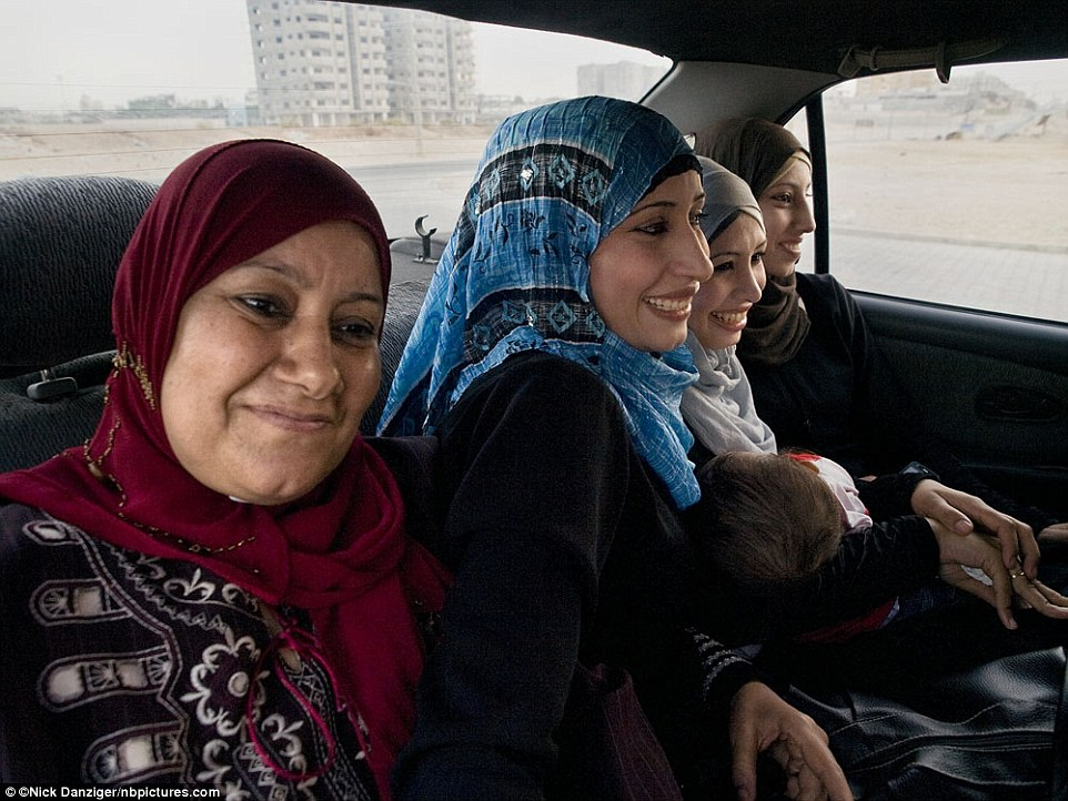 """Zakiya, now (left): 'My husband is still in prison, and my daughters are at university. I have been the """"head"""" of my family for 18 years.'"""