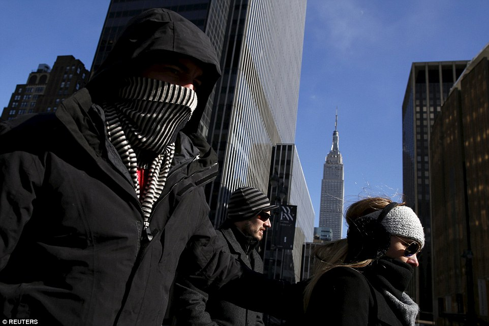 People walk down 8th avenue in New York on Saturday. Temperatures in the city broke Valentine's Day records on Sunday, reaching minus-one in Central Park