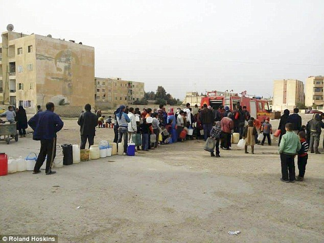 Full: Deir Ezzor hospital is said to be full of people suffering from malnutrition, on the point of death, while those who are strong enough queue for basics like water for up to 10 hours (pictured) as they wait for rescue