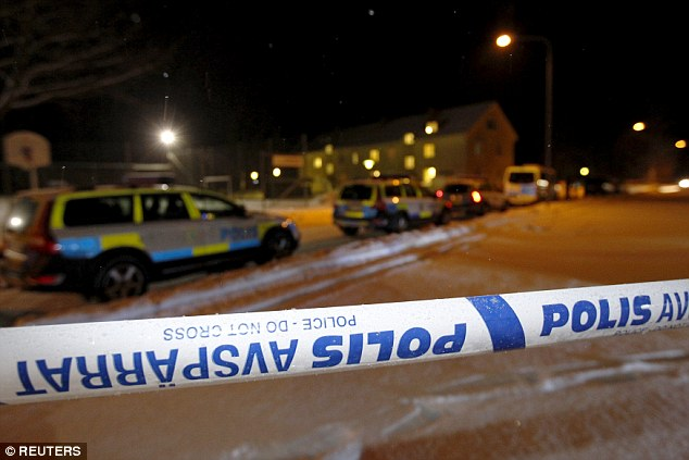 Police cordon off an asylum center in Ljusne, central Sweden, after a mass brawl between two gangs of migrant men saw one man stabbed to death and three injured