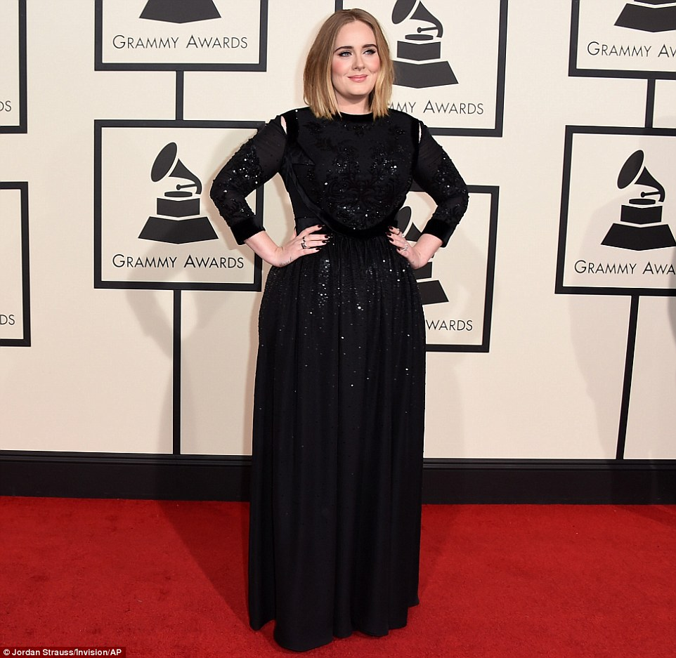 She's back: Adele made a triumphant comeback in a long-sleeved black gown which was adorned with sequins