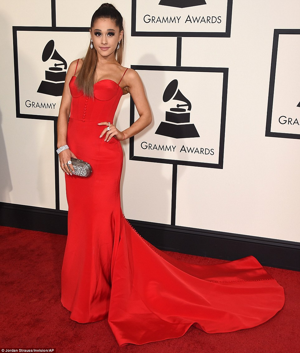 Scarlet woman: Ariana Grande showed her sexy side in a skintight red gown, complete with corseted top