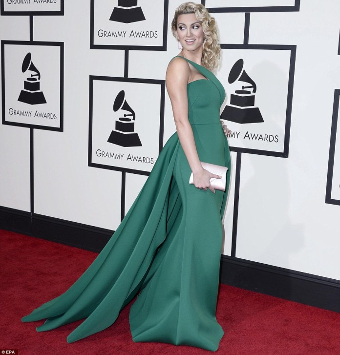 Making them green with envy: Tori Kelly was a sight to behold in a form-fitting green gown with full train