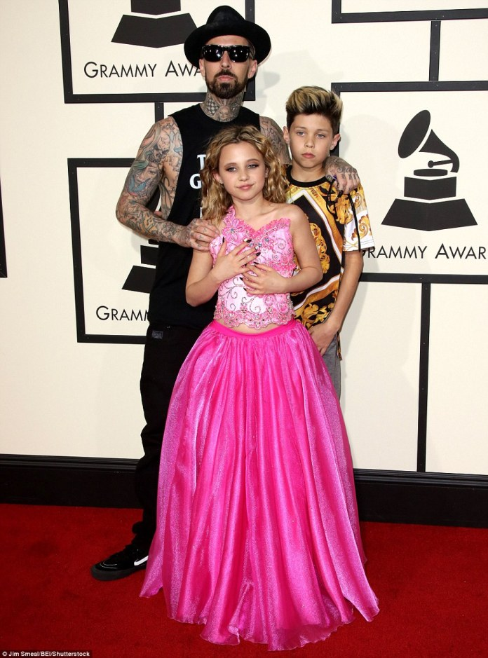 A family affair: Blink-182 drummer Travis Barker brought along his daughter Alabama Luella and son Landon Asher