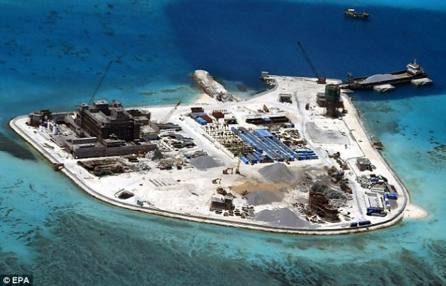 Land grab: An aerial view shows construction work by China on the Mabini in the disputed Spratly Islands