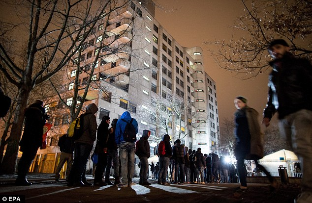 Rising: Crimes committed by Migrants and refugees, pictured in front of the State Office for Health and Social Affairs (LaGeSo) in Berlin on Tuesday,increased by 79 per cent from 2014 to 2015