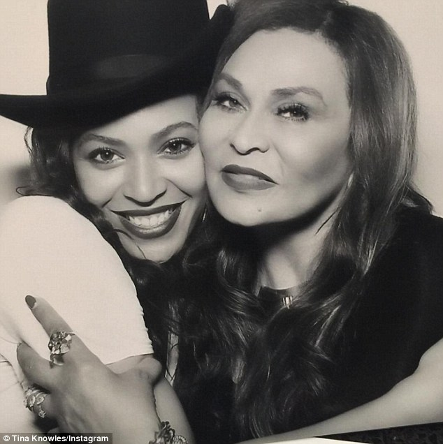 Twins: Beyonce posed with look-alike mother Tina during a photo booth session. 'Me and my baby hugged up tight!!' she wrote