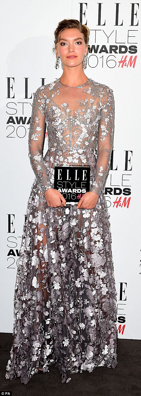 Fabulous frock: Arizona Muse posed up a storm with the Fashion Director's Woman of the Year Award