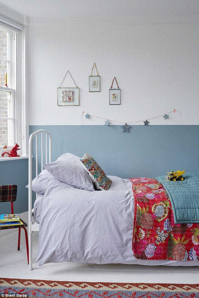 Celia painted a half wall of Farrow & Ball's Stone Blue (farrow-ball.com) in Oscar's bedroom. 'We didn't have much furniture when we moved in so I dressed the walls up with paint instead.' The blue eiderdown is from Camomile London (camomile.london) and Celia brought the patterned throw back from Rajasthan. She upcycled the chair by reupholstering it in tartan fabric