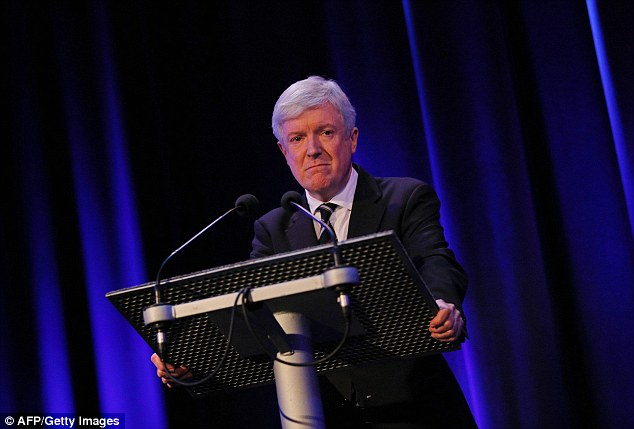 'Sorry': BBC Director General Tony Hall (pictured at the press conference) apologised to the victims of Savile and Hall, saying: 'I am deeply sorry for the hurt caused to each of you. We let you down and we know it'