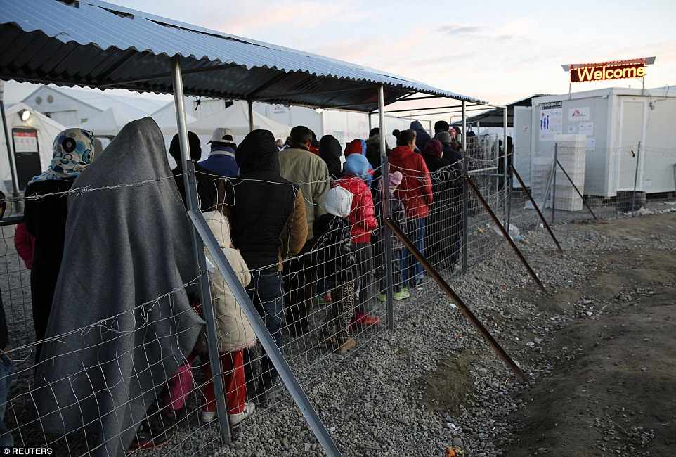 The EU remains deeply divided over how to handle the migrant crisis, especially over recent border closures by several member states that have threatened the passport-free Schengen area. Refugees are pictured lining up for food on the Greek-Macedonian border