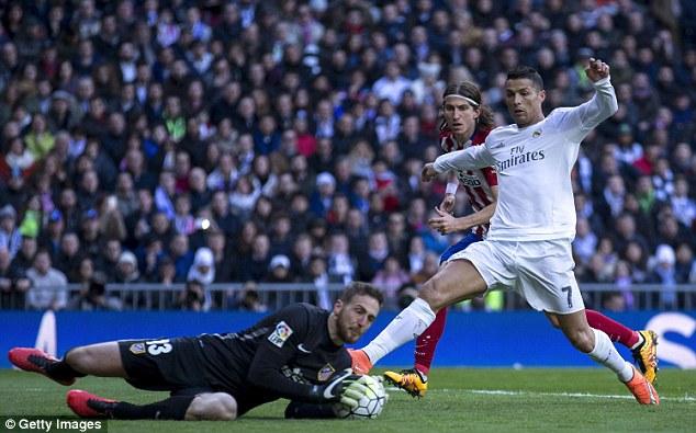 Atletico goalkeeper Jan Oblak (left) prevents Ronaldo getting to the ball at theEstadio Santiago Bernabeu