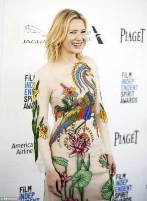 Letting her gown take centre stage: Cate kept her hair and beauty look simple and understated with her shoulder length locks styled in loose waves