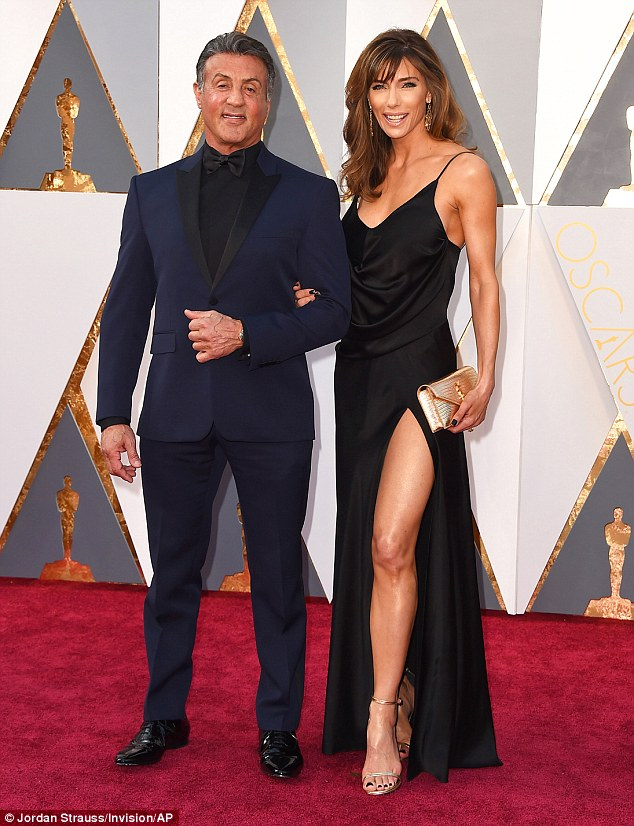 Rocky's back: Sylvester Stallone stole back the spotlight at The Oscars 2016 on Sunday alongside his beautiful in black wife Jennifer Flavin