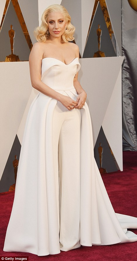A bit of all white: Best Original Song nominee Lady Gaga looked angelic in a white pantsuit with a train, byBrandon Maxwell