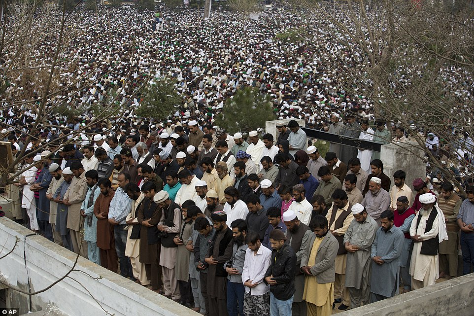 Supporters of Qadri pray in unison during his public funeral in Rawalpindi, a city next to Islamabad