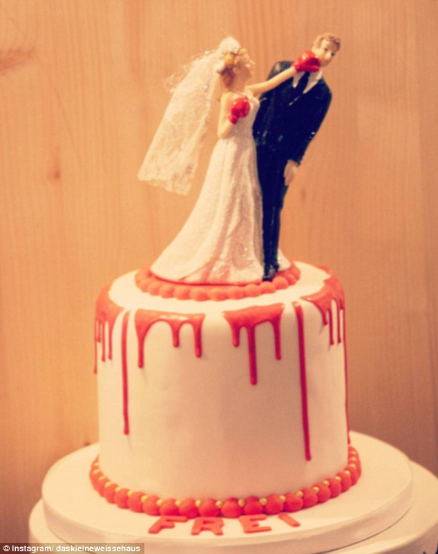 Freedom: Another cake was topped with a bride donning in gloves punching her groom in the face and completed with blood red icing dripping down the sides