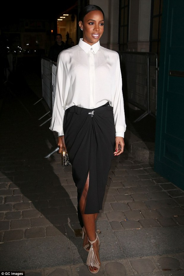 Work! The 35-year-old was as stylish as ever she got ready to take to the FROW in monochrome