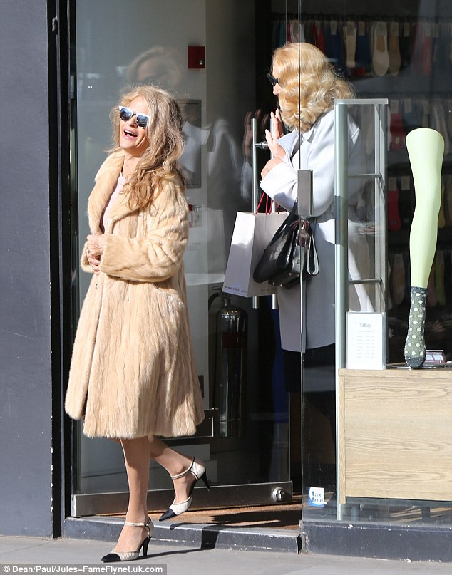 Jerry Hall was spotted shopping with a friend for tights on the Kings Road less than one hour before her Wedding to Billionaire media mogul Rupert Murdoch in London