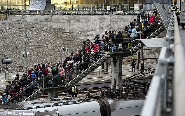 Concerns: What is worrying is that if the Stockholm station story has been blown out of proportion, it could have artificially fuelled pro-migrant sentiment and made ordinary Swedes less ready to voice their worries about mass migration. Above, people arrive in Stockholm