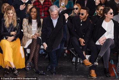 Front row friends:Lewis proved his talents don't just lie in racing as he showed off his style credentials in a fashion-forward jumperm, but sadly he was separated from his pal Kelly on the FROW
