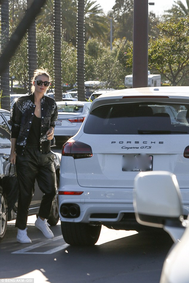 Sharapova, 28, was also spotted driving her Porsche to the supermarket on Tuesday afternoon. Porsche, said that while they are 'certainly not dumping' Sharapova, they are currently 'not pursuing any further activities' with her