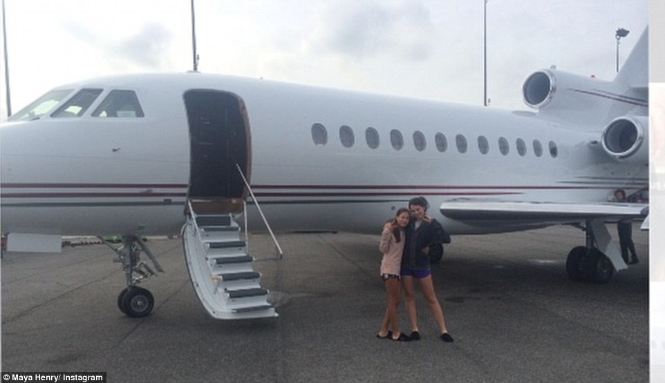 Jetset: Despite only being 15, Maya, pictured here outside what appears to be a private jet, leads a luxury lifestyle