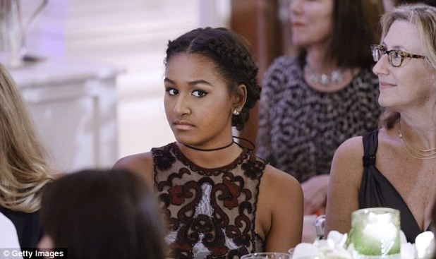 Sasha, aged 14, went for a semi-sheer black dress from the same designer as her sister and wore her hair in trendy braids, at her first White House state dinner