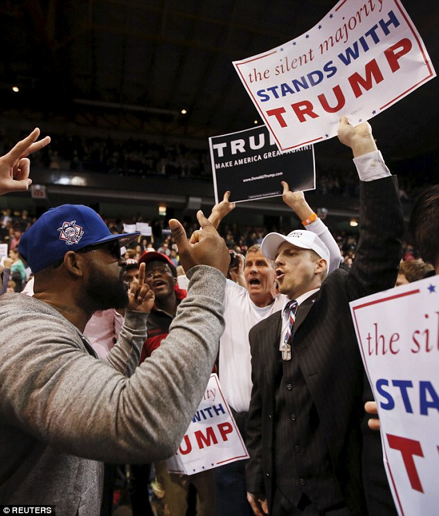 Verbal exchange: Trump supporter exchanges words with a demonstrator  after Republican U.S. presidential candidate Donald Trump cancelled his rally at the University of Illinois at Chicago