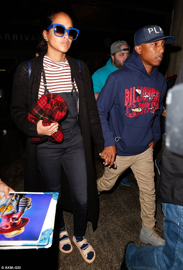 2f7f9d07160a1 Side by side! Pharrell Williams and wife Helen Lasichanh hold hands ...