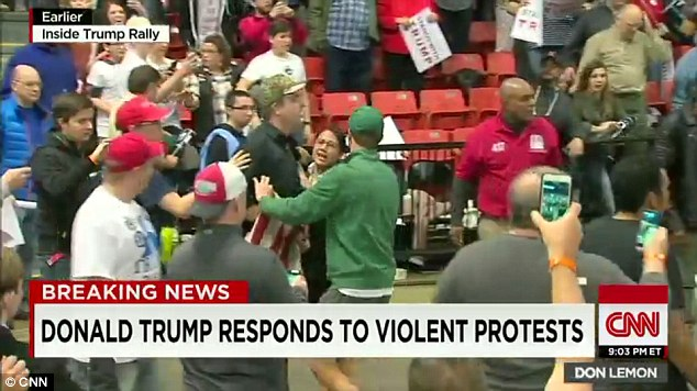 Heated: Unprecedented scenes inside the University of Illinois at Chicago Pavilion between an anti-Trump mob and Chicagoans who came to hear the Republican front-runner speak
